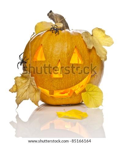 A scary old jack-o-lantern on white - stock photo