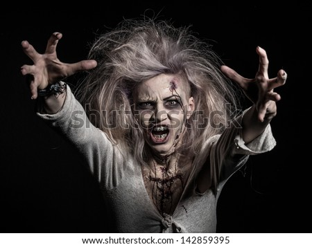 a scary undead zombie girl - stock photo