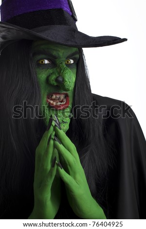 A scary witch, contemplating evil thoughts. White background. - stock photo