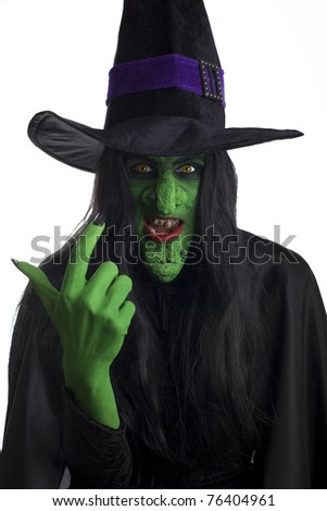 A scary witch, signaling come here. White background. - stock photo
