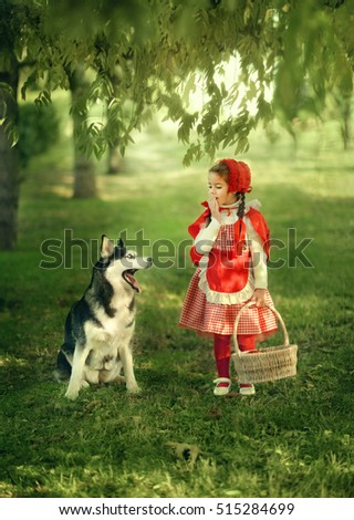 a scene from a fairy tale forest girl red cap with a basket and the Grey Wolf