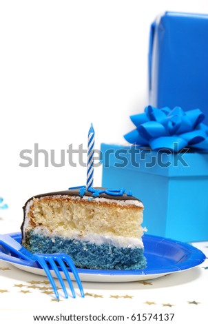 A scene out of a birthday party with a slice of cake. - stock photo