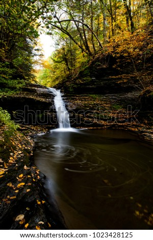 A scenic, autumn view of cascades along She-Qua-Ga Creek near Watkins Glen and Montour Falls, New York.