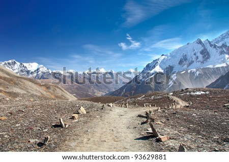 A scenic trail to the lake Tilicho in Nepal - stock photo