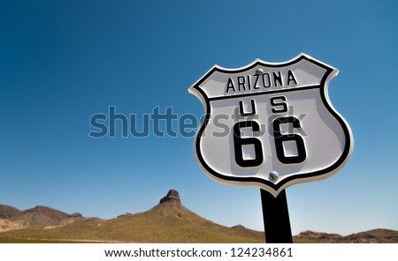 A scenic view of a historic Route 66 sign with a sky blue background - stock photo