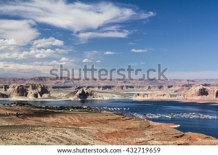 A scenic view of Lake Powell with a city and a small harbor