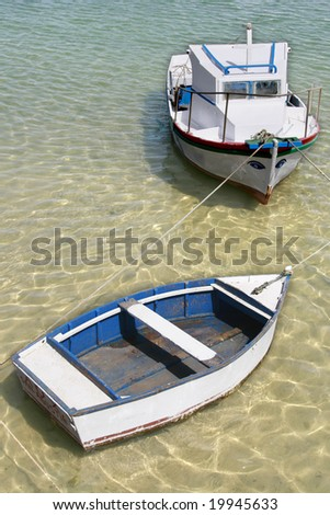 a scenic view of two boats docked - stock photo