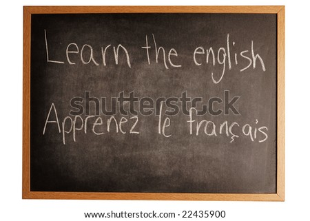 a school board with 2 languages wrote on it. French and english - stock photo