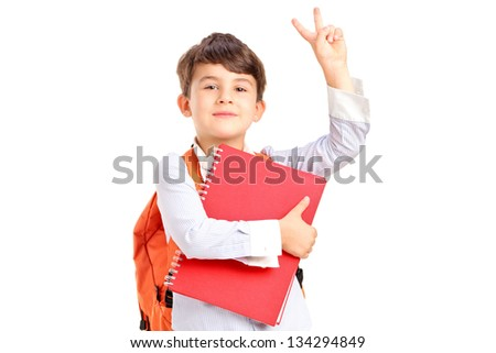A school boy holding a notebook and gesturing isolated on white background