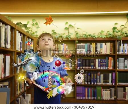 A school boy is opening up a book with icons such as letters, formulas and nature symbols around him for an education or science  - stock photo