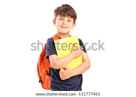 A school boy with backpack holding a notebook isolated on white background f - stock photo