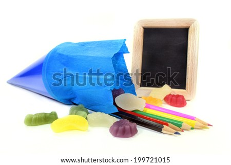a school cone with crayons and sweets - stock photo