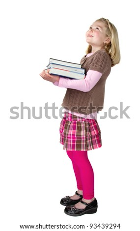 A school girl holding books and looking up, isolated on a white background