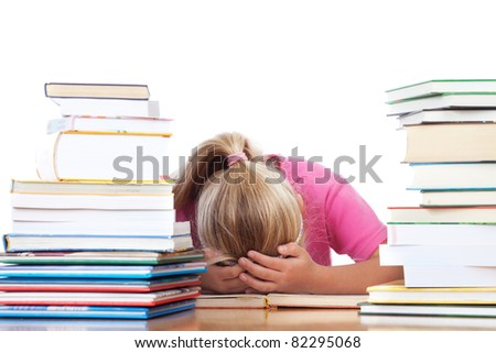 a school girl lying on desk frustrated between many books - stock photo