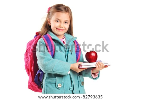 A school girl with backpack holding notebooks and red apple isolated on white background