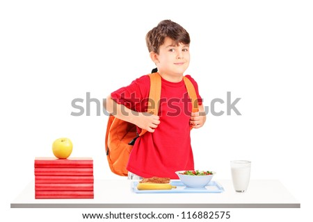 A schoolboy preparing for lunch isolated on white background - stock photo