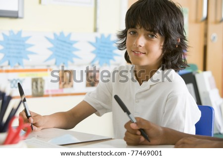 A schoolboy studying in class - stock photo