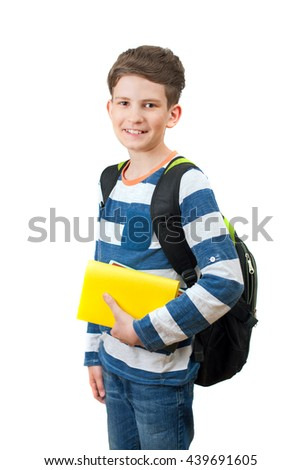 A schoolboy with book and backpack isolated on white background