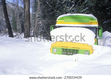 A schoolbus buried in snow, Aspen, CO - stock photo