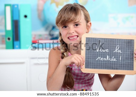 a schoolgirl showing a slate - stock photo