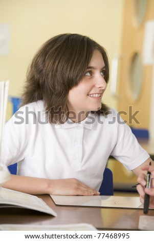 A schoolgirl studying in class - stock photo
