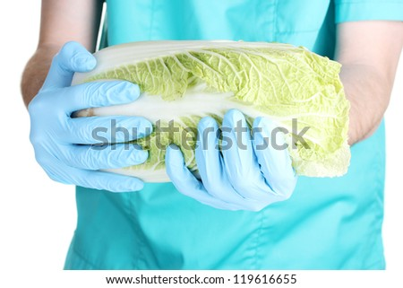 A scientist holds a genetically modified vegetable - stock photo