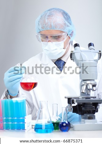 A scientist man working in laboratory