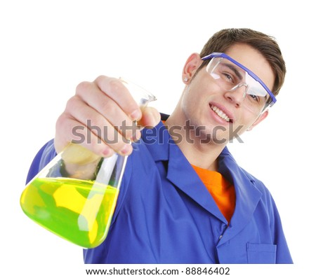 A scientist with a chemical reaction in a flask - stock photo