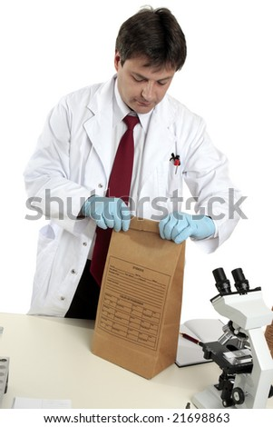 A scientist with a crime scene evidence bag - stock photo