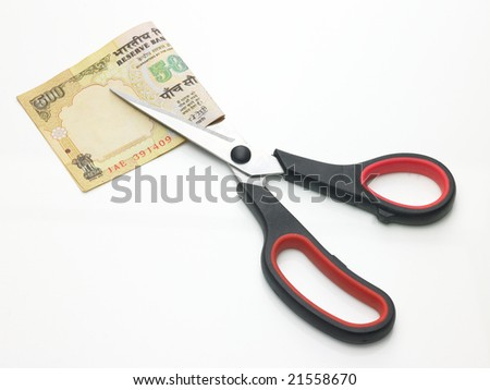 A scissor with the currency notes - stock photo