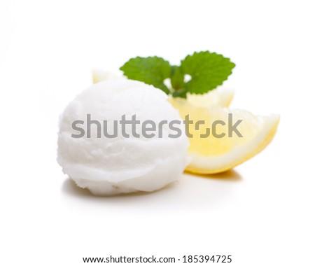 A scoop of lemon ice cream isolated on white background - stock photo