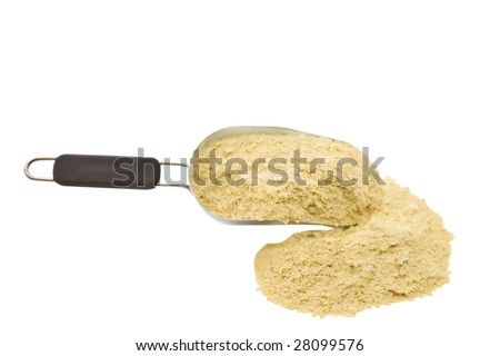 A scoop of nutritional yeast flakes isolated on a white background. - stock photo