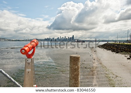 A scope looking at downtown Seattle across the water - stock photo