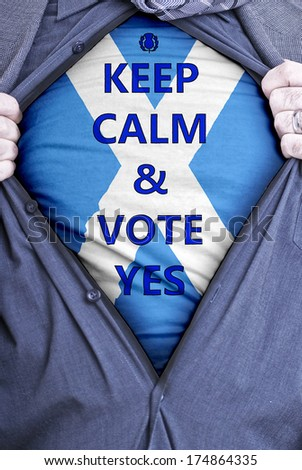 A Scottish businessman rips open his shirt and states for voters to vote yes in the 2014 vote for Scottish independence. - stock photo