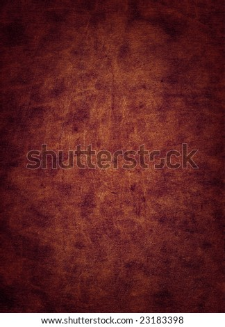 A scratched red leather surface, suitable as a background texture. - stock photo