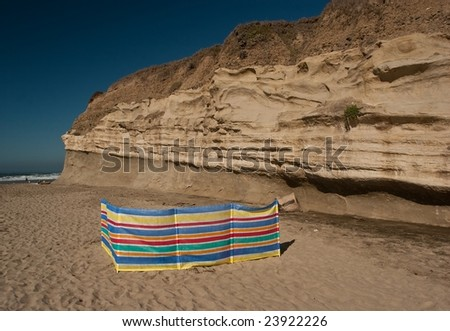 A screen for protection against the wind on a beach.