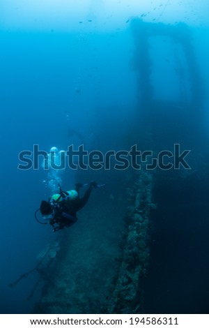 A scuba diver explores a shipwreck that was sunk during World War II in the Republic of Palau. Many Japanese ships were sunk by American planes in Palau's lagoon during 1944.