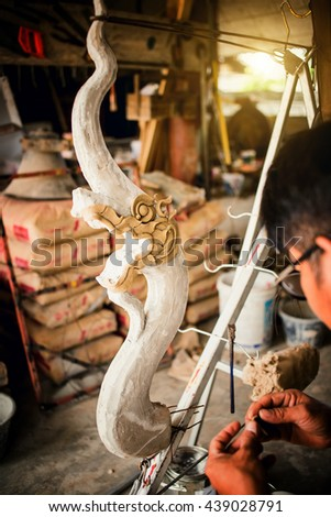 A sculptor working  great Naga in THAILAND