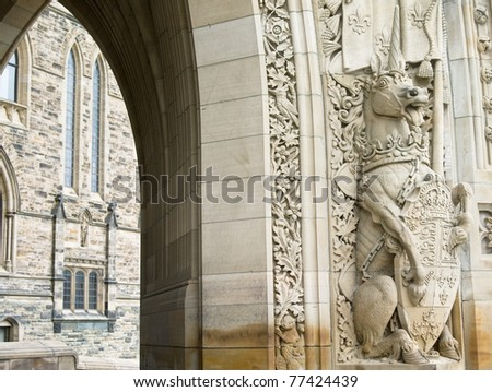 A sculpture of a unicorn holding the shield of Canada at the entrance of the Parliament buildings in Ottawa. - stock photo