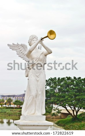 a sculpture of Angel calling to Heaven - stock photo