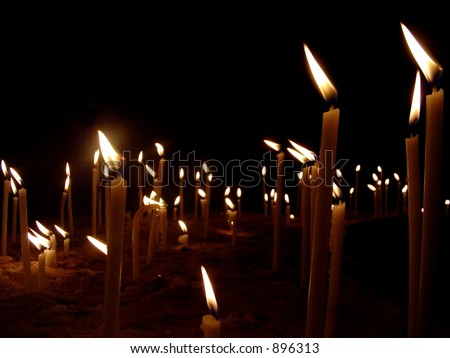 "A ""sea"" of candles - stock photo"