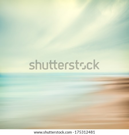 A seascape abstract with panning motion combined with a long exposure.  Image displays soft, pastel colors in a retro style. - stock photo