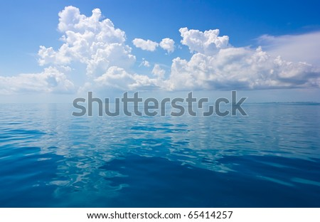 a seascape with beautiful clouds and turquoise ocean