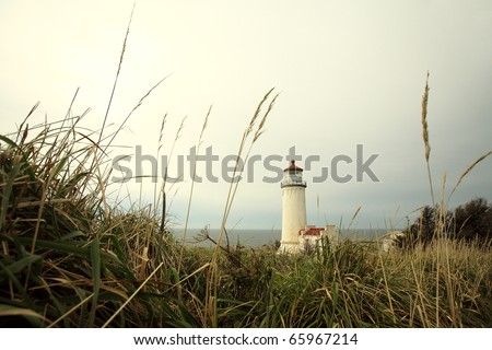 A seaside lighthouse overlooking the sea. - stock photo