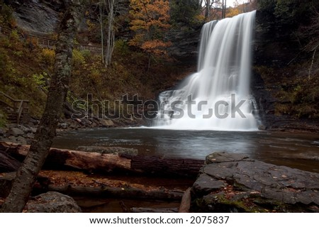 A secluded waterfall in the forests of Virginia. I like this type of waterfall with its many ledges for the water to tumble across. - stock photo