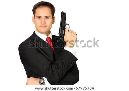 A secret agent posing with his gun - stock photo
