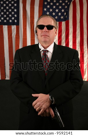 a Secret Service Agent stands at the ready - stock photo