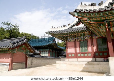 A section of the Changdeokgung Palace showing the spectacular architecture of ancient Korea. - stock photo