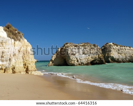 A section of the idyllic Praia de Rocha beach on the southern coast of the Portuguese Algarve region. - stock photo