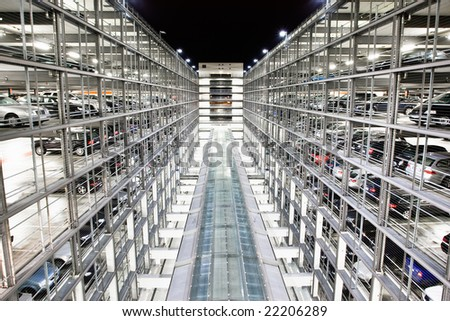 A secured public car park at night - stock photo